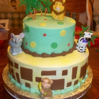 Zoo Babies 10 & 6 in Cakes iced in bc with fondant accents.