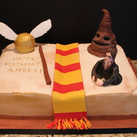 Harry Potter Cake covered in fondant. Harry is made from gumpaste, the sorting hat and the snitch are made from RKT and covered in fondant. Enjoy!