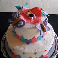 Butterflies chocolate cake with vanilla buttercream; baby and decorations made with fondant