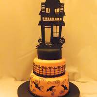 Haunted House   Cakes covered in fondant, details in BC, made the house with color flow, but it broke and this one is cardstock.