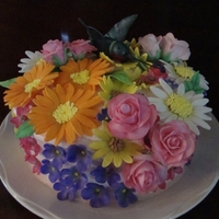1337039940.jpg Fondant and gumpaste flowers and hummingbird.