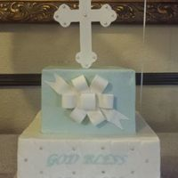 Grayson's Baptism Cake Buttercream cakes with fondant bow and cross. The lighting was very dim, so they didn't photograph very well.
