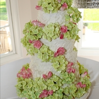 Hydrangea Rose Wedding Cake 550 individual hydrangea blooms on this cake. Approx 30 roses.