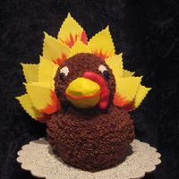 Mr. Turkey I had seen this cake on Wilton's web site years ago. I used different cutters for the feathers but liked it just as much!