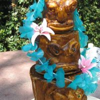 Tiki Birthday Cake This is modeled after a Susan Carbury cake. The party was held at Disneyland for two Tiki Room lovers.