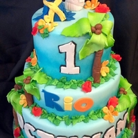 Rio This cake was inspired by the movie Rio. All fondant decorations. So fun to make this one and I love how it turned out. (I think it's...