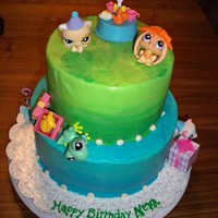 Neva Hunt 6Yrs Littlest Pet Shop Cake frosted in cream cheese Frosting.