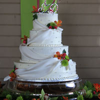 Swags Cake is frosted in butter cream all layers a a different flavor, This cake was for an outdoor wedding I was so afraid the swags would not...