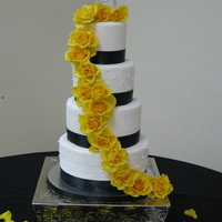 Alisha 4 tier white fondant with pearl sheen, black satin ribbon and fresh yellow roses. Thanks to soygurl for her help in giving me advice about...