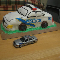 Police Car Cake for a friend's graduation from police academy - I was very sick and pregnant so I forgot to cover the cake board with foil (DOH!).