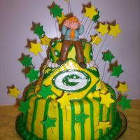 Green Bay Packers Birthday cake for my SIL. WASC with chocolate raspberry oreo filling. All fondant. My SIL is on the top layer wearing his cheesehead hat...