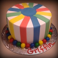 Stripes Butter cream cake with fondant stripes & bubble gum border. Inside of cake has primary polka dots.