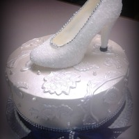 Cinderella White Chocolate shoe on a butter cream cake with fondant appliques.