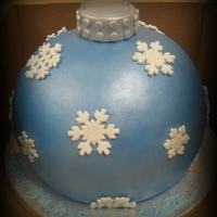 "Ornament Cake 8"" double carved...covered in fondant. Snowflakes are pre-bought sugars."