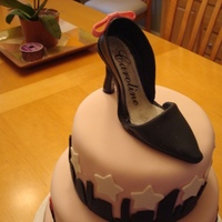 Shoe Cake This cake has a fashion/ciy theme. Gumpaste shoe and decorations with rhinestones. Homemade MMF.