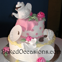Tea Party Bridal Shower Cake 6 & 12 inch cakes. Used fondant in old Wilton chocolate tea set molds for a quick cake.