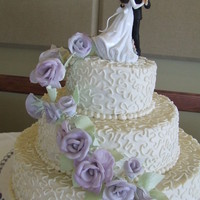 Purple Roses My nephew's wedding cake, vanilla with vanilla bc, gumpaste roses. This is from 2010.