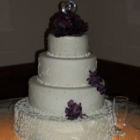 Kourtney's Wedding This cake is all dummy, except the top tier. It was so easy to do! My dh would rather I only make dummies now! LOL! The flowers are silk,...