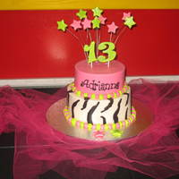 13Th Bday 2 tier cake, decorated in all buttercream, the topper is fondant dried out and put on wires, (the numbers are attached with chocolate to...