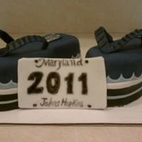 Taking A Journey   I was asked to make a graduation cake of flip flops for a Johns Hopkins graduate.