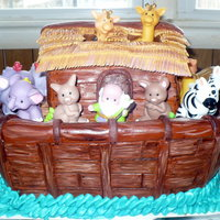 Noah's Ark White cream cheese pound cake with buttercream filling and MMF. I cut out and hand painted each board to look like wood. Mom wanted the...