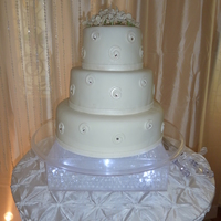 Hydrangea & Swarovski Wedding Cake Simple white wedding cake decorated with Swarovski in center of each hydrangeas on top of cake and in center of spiral design around each...