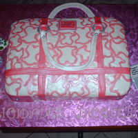 Tous Handbag Cake!  It was a real challenge to make all of those bears logos each by one of 50/50, the brazalete,earrings and ipod are made of gumpaste,the...