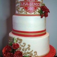 Harley Inspired Wedding Cake Round Butter Cream Covered Tiers. Harley Shaped Plaque In Red With Khaki Filigree And Red Gum Paste Roses.