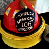 Fire Chief Groom Life size Helmet Cake on A Rolled Fire Hose Cake. Both Red Velvet With Cream Cheese Under 10# Of Fondant. Distressed To MAtch His Actual...