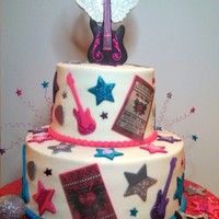 Rock Star Birthday Cake Rock Star themed cake with butter cream icing and fondant decorations.