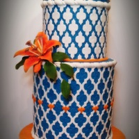 Contemporary Moroccan Wedding Cake Full fondant with gum paste stargazer lilly. Pleated fondant base board.