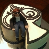 1322109172.jpg This is a cake made for a musician named Butch Walker. The spade was made to look like his album cover art work. That is him sitting on his...