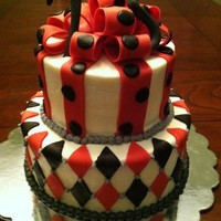75Th Birthday Red and black themed birthday cake.