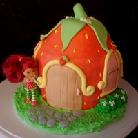 Strawberry Shortcake House WASC with buttercream and MMF decorations. I used a cupcake pan to get the shape. So much fun to do. Thanks to cc4u for the inspiration!