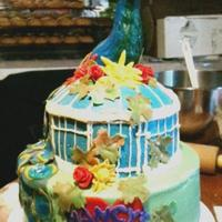 A Peacock For Mom I made this cake for my Mom's 60th birthday. Choc cake with PB creamcheese icing and fondant accents.