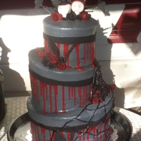 "Halloween Wedding Choc cake, PB icing.. accents in fondant. ""blood"" was red choc ganache. Thanks for looking"