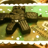 Ar 15 Assult Rifle carved vanilla cake with Bailey's BC icing and covered in dark modeling choc. Sadly the butt and forward grip is too short so not...