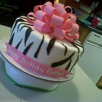 Birthday Cake With Bow This is a zebra print birthday cake with a hot pink bow. the inside is butter cake layer, chocolate cake layer, butter cake layer and...