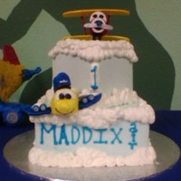 Maddix Air 1 This was done for a friend's baby's first birthday. Had so much fun making the gumpaste airplane figures. The cake was a 2 tier...