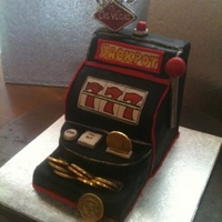 "1316829560.jpg Slot machine cake inspired by a cake I found on here by BernieBeaver. It was small I used four 6"" x 2"" square chocolate cakes..."