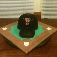 Escobar Grooms Cake Texas Tech baseball cap. German choc cake filled with coconut caramel pecan icing. Crumb iced with dark chocolate ganache and iced with...