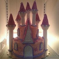 Makayla's Princess Castle Birthday Cake Tiered Round Cake with Store Bought Castle Kit for Turrets, Doors, and Windows.