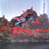 Dirt Bike Cake Super easy to do! Bake your cakes, then mound up pieces to make hills. I used brown sugar sprinkled over the chocolate icing to make it...