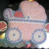 "Pink & Purple Baby Carriage Cake ""It's A Girl"" made from white chocolate."