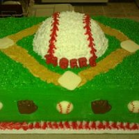 "T-Ball League Cake All buttercream and all cake. Small baseballs, bases, ""Tigers"", and gloves are made from melting chocolate."