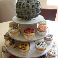 "Star Wars Death Star Cake And Cupcakes death star made from wilton sports ball, covered in buttercream and sprayed with silver ""spray paint"" icing....characters made..."