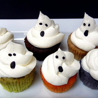 Ghost Cupcakes ghost cupcakes in fall flavors (butternut squash, avocado, chocolate and red beet, ube (purple yam)..topped with cool whip, eyes/mouth made...