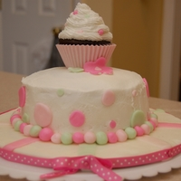 Little Girls Smash Cake 6 in round with pudding in the middle. Cupcake on top. Fondant decorations.