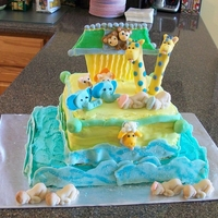 Baby Shower Cake Chocolate cake, butter cream icing and fondant and modeling chocolate decorations.
