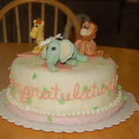 My First Jungle Themed Baby Shower Cake My first attempt at molding animals out of fondant for a little girl. I had a lot of trouble keeping the heads, arms and legs attached...